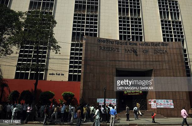 People stand outside the Reserve Bank Of India as the bank employees participate in a rally organised in support of the all India General Strike in...