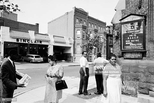 People stand outside the Wesley AME Zion Church in Washington DC where the funeral was held for slain civil rights leader Medgar Evers prior to his...