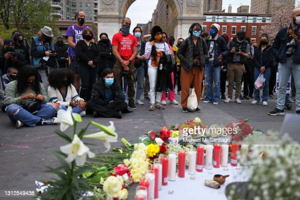 People stand silently during a vigil for Daunte Wright and Dominique Lucious at Washington Square Park in Manhattan on April 14, 2021 in New York...
