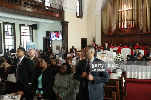People stand with their backs to Democratic presidential candidate, former New York City mayor Mike Bloomberg as he speaks during a worship event at...
