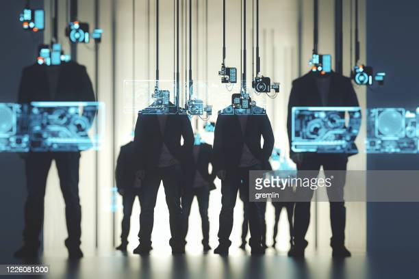 people standing against suspended computers - digital viewfinder stock pictures, royalty-free photos & images