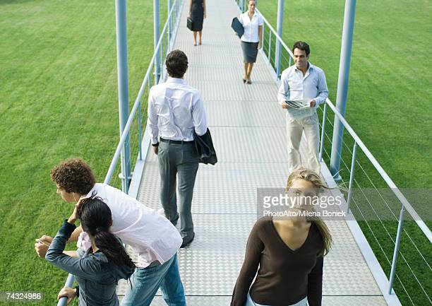 people standing and walking on walkway - 通過する ストックフォトと画像