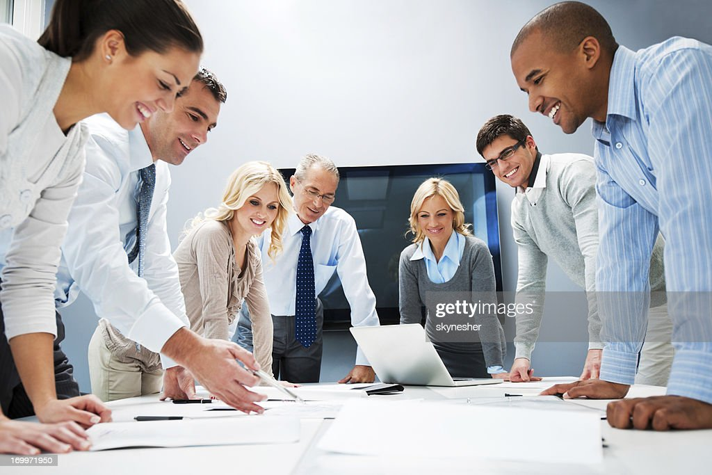 Image result for people standing around a table