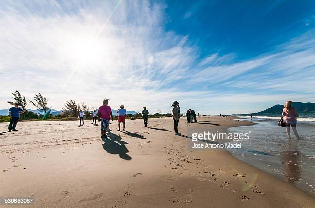 People standing at Praia do Sonho in the city of Palhoça next to Florianópolis Brazil Taken in August 3rd 2014