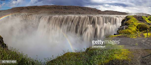 people standing at the dettifoss xxl panorama - dettifoss waterfall stock photos and pictures