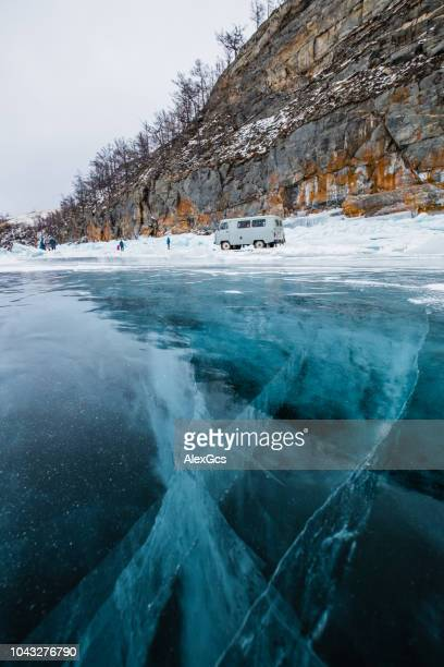People standing by the edge of a frozen lake, Siberia, Russia