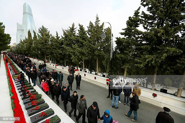 People standing during their visit to the Alley of Martyrs to commemorate the victims of January 19201990 Citizens of Baku visits the Alley of...