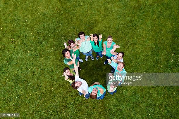 people standing in a circle on grass - human body part stock pictures, royalty-free photos & images