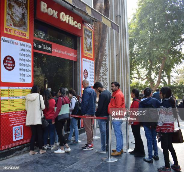 People standing in a queue to get tickets to watch the movie Padmavat at cinema hall on January 25 2018 in Chandigarh India According to the film's...
