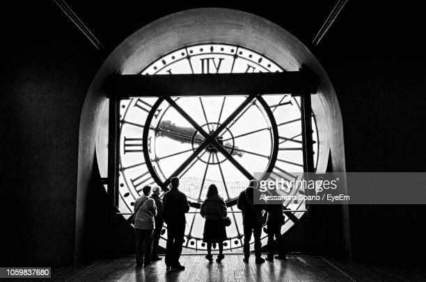 People Standing In Clock Tower