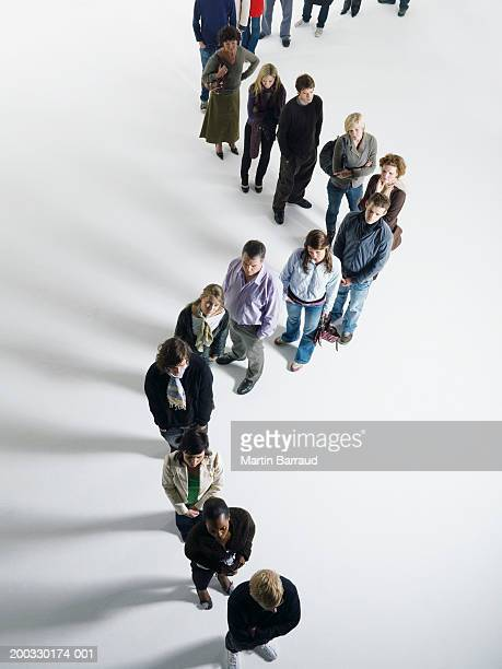 People standing in curved line, elevated view