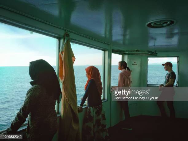 people standing in ferry sailing on sea - passagerarbåt bildbanksfoton och bilder