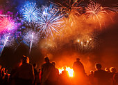 People standing in front of colorful Firework