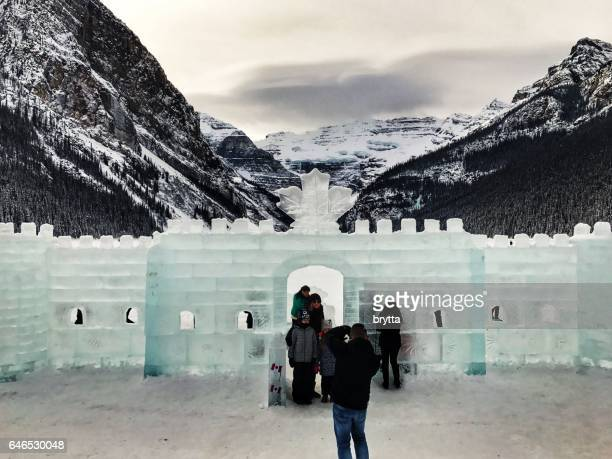 People standing in front of the ice castle during the annual Ice Sculpture Festival at Lake Louise in Banff National Park, Alberta,Canada