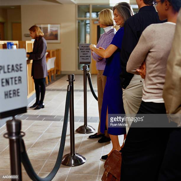 people standing in line at a bank - lining up stock pictures, royalty-free photos & images