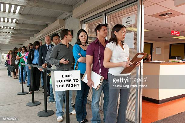 people standing in line at job and training fair - lining up stock pictures, royalty-free photos & images
