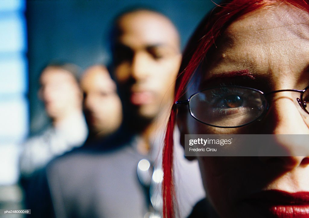 People standing in line, focus on woman's face : Stockfoto