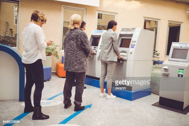 People standing in line for ATM