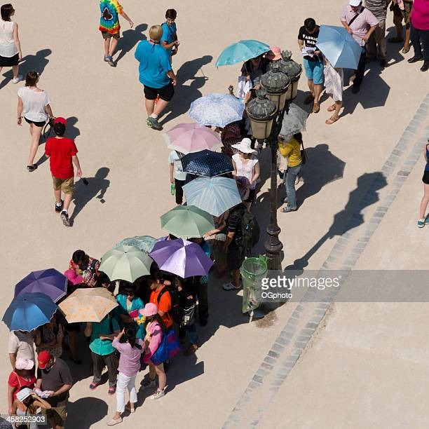 people standing in line holding colorful umbrellas - ogphoto stock pictures, royalty-free photos & images