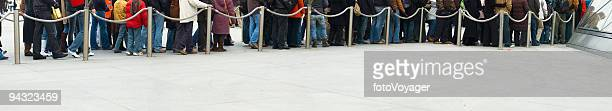 people standing in line - lining up stock pictures, royalty-free photos & images