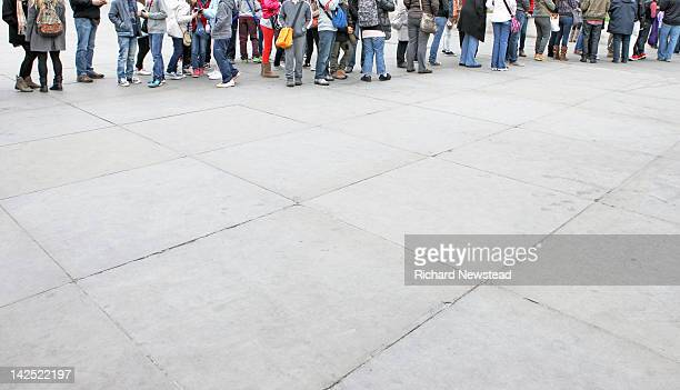 people standing in queue - lining up stock pictures, royalty-free photos & images
