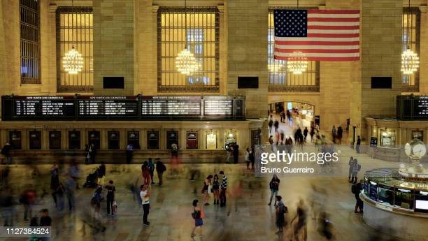 people standing inside grand central station - grand central station manhattan stock pictures, royalty-free photos & images