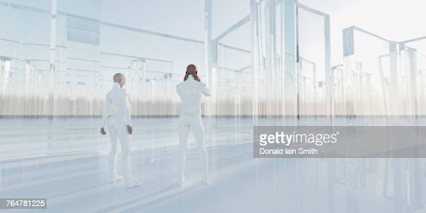 people standing near glass maze - digital composite stock-fotos und bilder