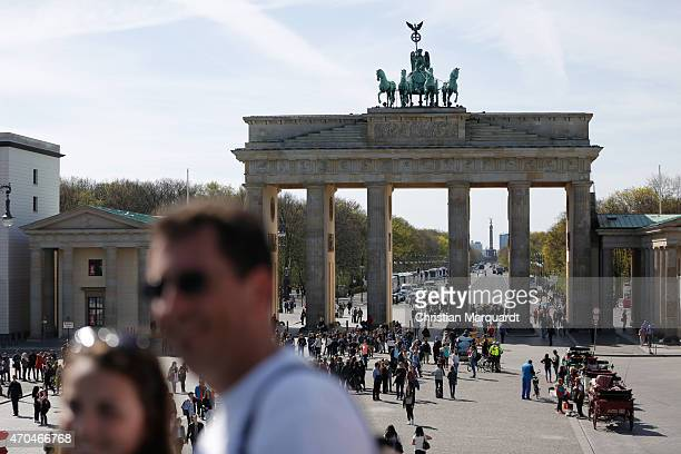 People standing next to the Brandenburg Gate during a sunny day on April 20 2014 in Berlin Germany Berlin is the capital of Germany and on of the 16...