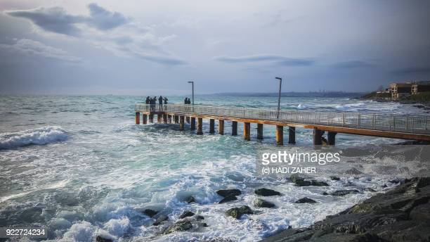 People standing on a jetty on the shores of Marmara Sea | Istanbul