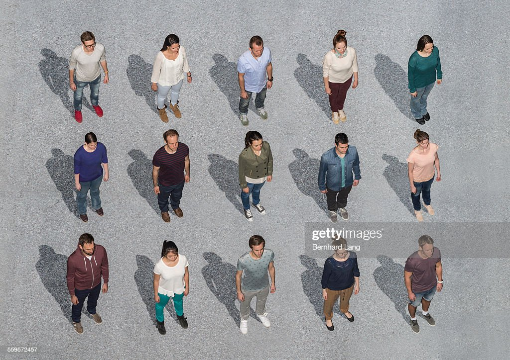 People Standing On Asphalt Ground Aerial Views Stock Photo
