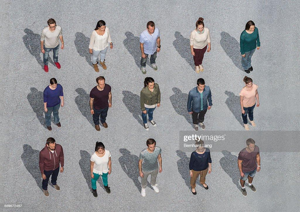 People Standing On Asphalt Ground Aerial Views