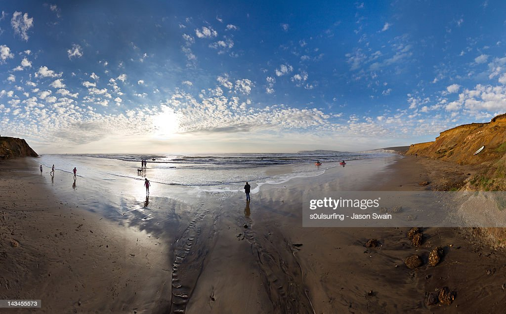 People standing on beach at Compton Bay : Stock Photo