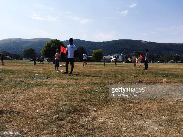 people standing on field against mountain range - harriet stock photos and pictures