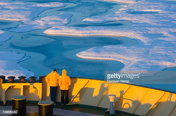 People standing on icebreaker ship in sea, elevated view