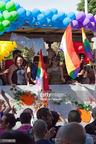 People standing on parade truck and holding some rainbow flags during the annual Gay Pride in Rome, Italy, on June 15, 2013. Members of Italian LGBT...