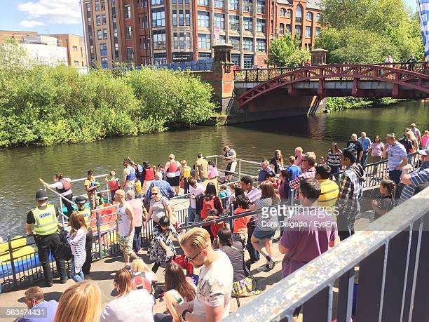 people standing on pier over river soar against bridge and buildings - leicester stock pictures, royalty-free photos & images