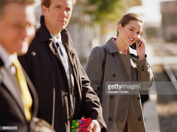 people standing on railway platform waiting for train - overcoat stock pictures, royalty-free photos & images