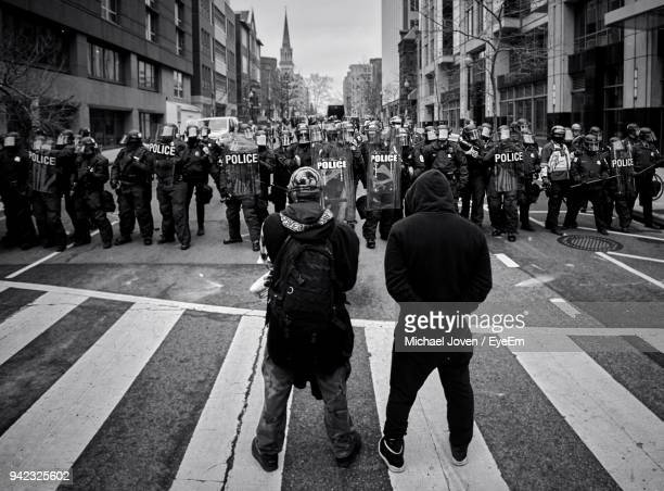 people standing on street in city - demonstrant stock-fotos und bilder
