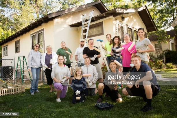 People standing outside of home