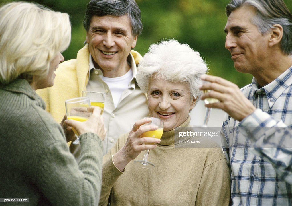 People standing together with drinks in hands, close up. : Stock Photo
