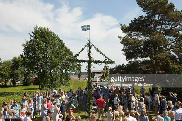 People standing under maypole