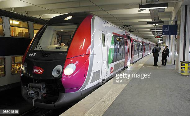 People stands by a new Nouvelles Automotrices Transilien Bombardier train of the SNCF Transilien the public transport railroad network in Paris and...