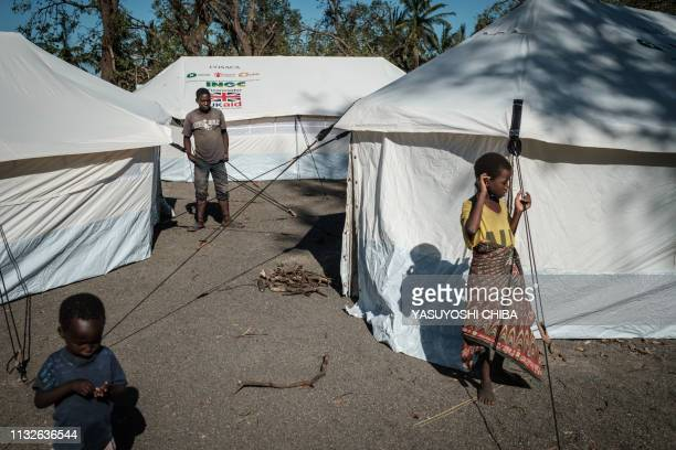 People stay at an evacuation site after losing their homes after the passage of the cyclone Idai in Tica Mozambique on March 24 2019 Cyclone Idai...