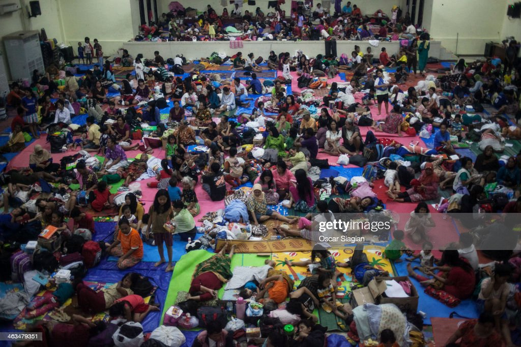 People stay in a goverment shelter at Bidara Cina Sport Center after being displaced by flooding on January 18, 2014 in Jakarta, Indonesia. Over 40,000 people have been displaced after heavy rains have severly fooding northern Indonesia and has left at least 13 dead.