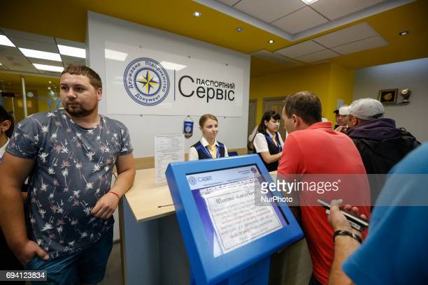 People stay in queue at a Idesk at the Center for registration of the biometric passports in Kyiv Ukraine June 8 2017 Ukrainians make out biometric...