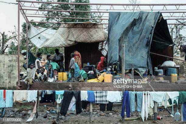 TOPSHOT People stay in shelter at the Ring ground in Buzi Mozambique on March 23 2019 The death toll in Mozambique on March 23 2019 climbed to 417...