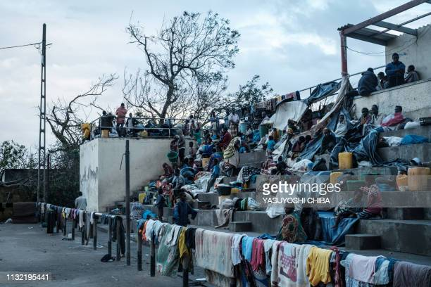 People stay in shelter at the stands of Ring ground in Buzi Mozambique on March 23 after the area was hit by the Cyclone Idai The death toll in...