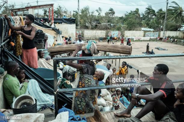 People stay in shelter at the stands of Ring ground in Buzi Mozambique on March 23 2019 The death toll in Mozambique on March 23 2019 climbed to 417...