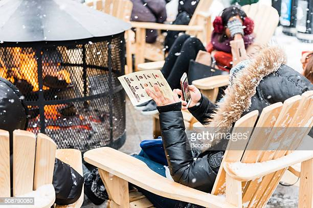People Stay Warm by Fire Outdoors in Old Montreal Winter