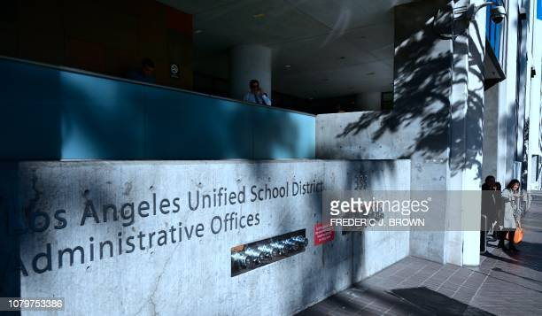 People step out of the Los Angeles Unified School District headquarters in Los Angeles, California on January 9, 2019. - Teachers in the nation's...